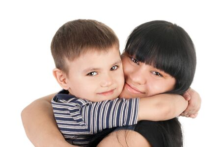 smiling young mother embracing her little boy 스톡 콘텐츠