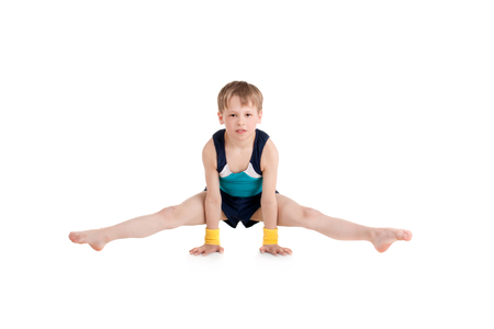 little boy gymnast doing exercises