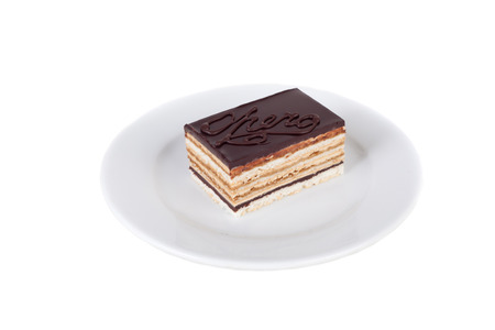 chocolate multilayer biscuit cake on the plate