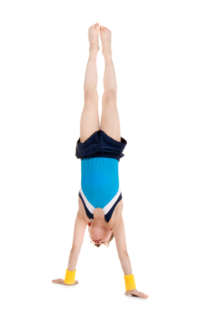 little boy gymnast standing head over feet Standard-Bild