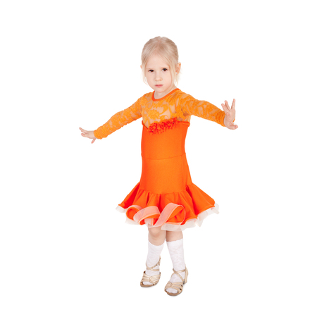 pretty little girl dancing in the ball dress Stock Photo