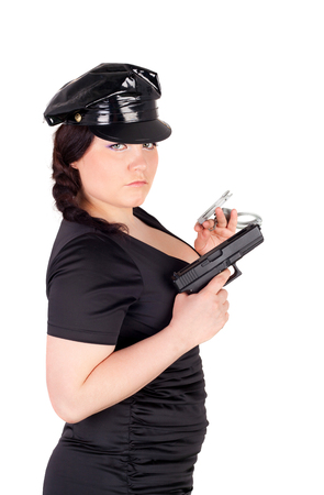 young beautiful police woman with the gun and handcuffs Stock Photo