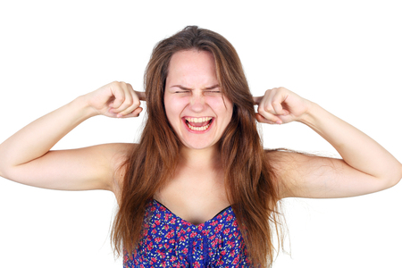 pretty young girl screaming and holding her ears closed
