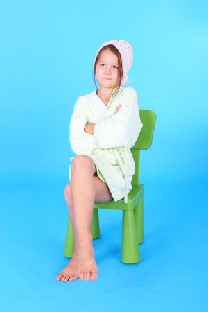 pretty cute little girl in the bath robe