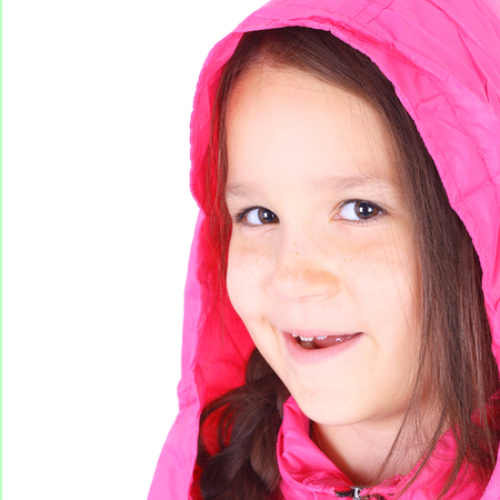 cute little smiling girl in the pink jacket closeup