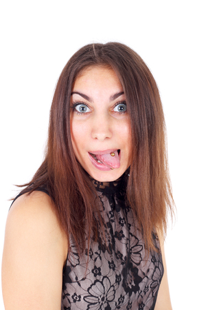 pretty young expressive girl with the piercing in her tongue