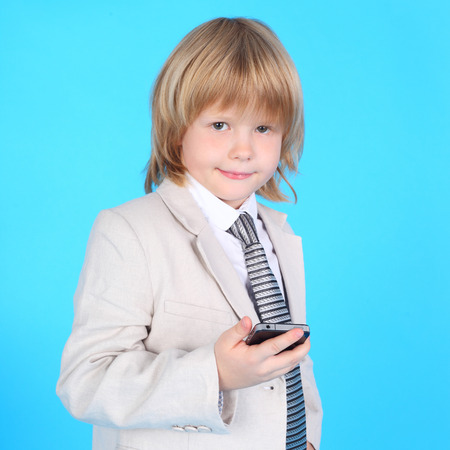 little gentleman with the mobile phone closeup