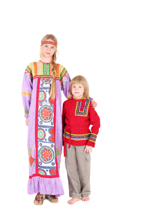 pretty teen girl and little boy wearing russian folk clothes Stock Photo