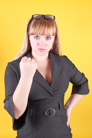 pretty young blond girl threatening with her fist