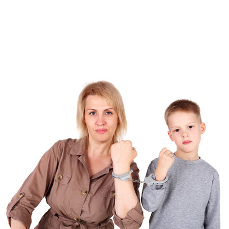 Mom and son chained with the handcuffs Stock Photo