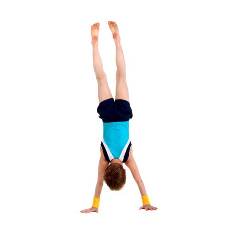 little boy gymnast standing head over feet Archivio Fotografico