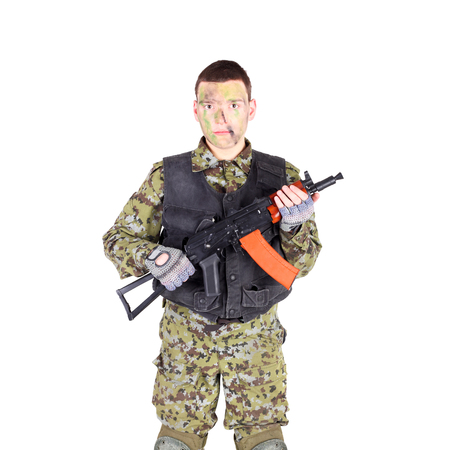 Soldier in camouflage on a white background