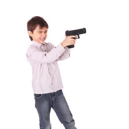 cute little boy playing with the pistol Reklamní fotografie