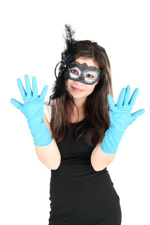pretty girl in the festive dress and mask showing the rubber gloves