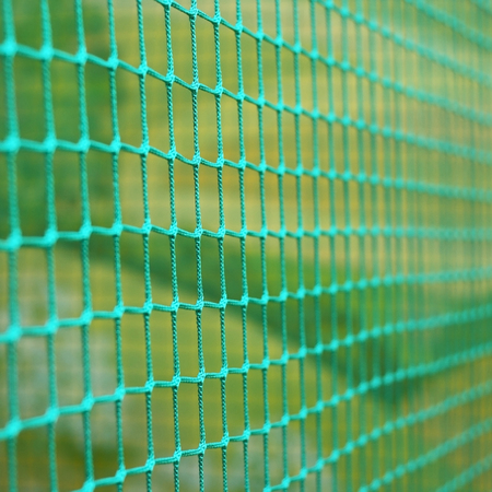 the green braided net used as a fence