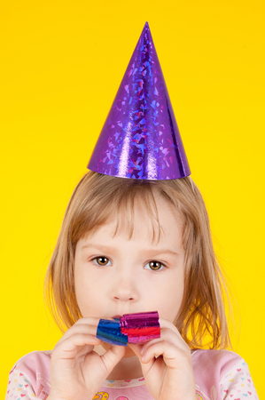 closeup image of the pretty little girl in the birthday cap