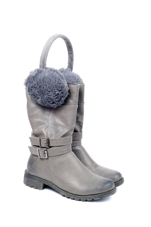pair of grey boots and flaps closeup
