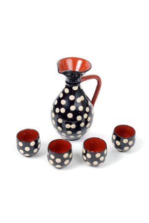 ceramic spotted cognac set isolated on white