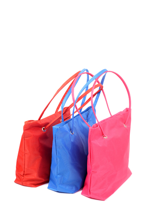pink, blue and red bags closeup