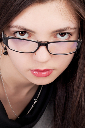 pretty young brunette girl wearing the glasses