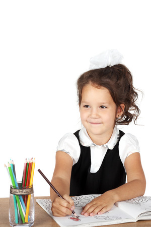 happy smiling pretty girl drawing something with pencils Stock Photo