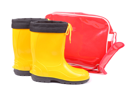 bright red bag and yellow rubber shoes