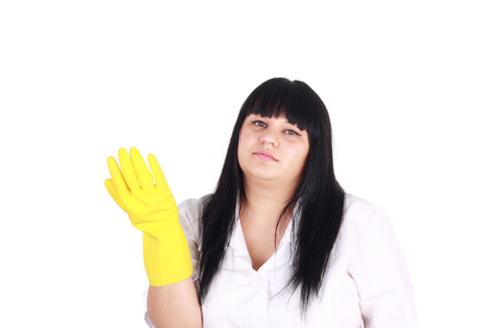 closeup image of the beautiful young girl in the white uniform and yellow rubber gloves