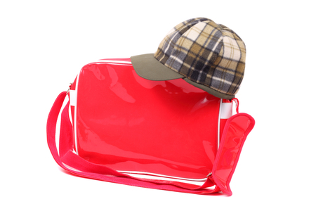 bright red bag and green cap