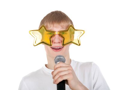 young guy in the funny glasses singing with the microphone