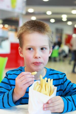 handsome little boy with the french-fried potatoes