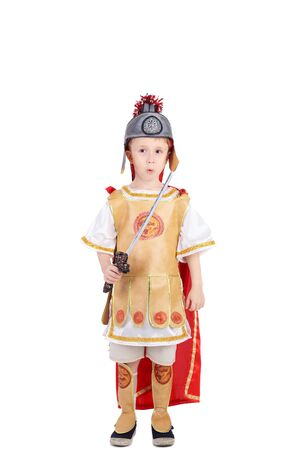 handsome little kid in the costume of the roman legionary