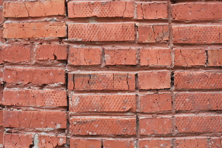rough crooked red brick wall