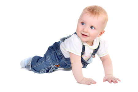 cute little baby creeping and smiling isolated on white