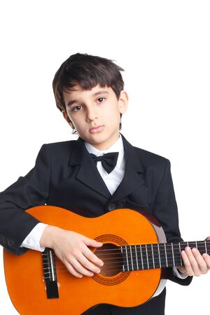 handsome little boy with the guitar isolated on white
