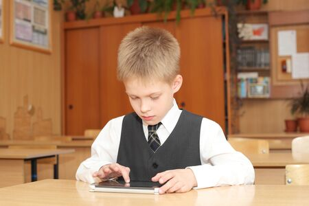 cute little boy with the tablet pc