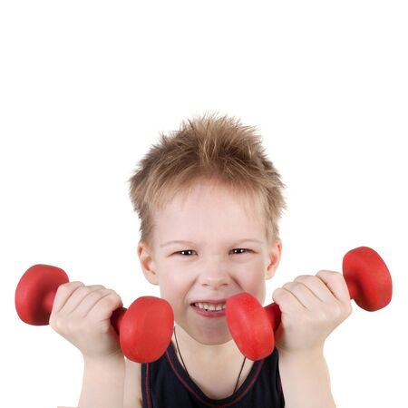 cute sly little boy training with the dumbbells