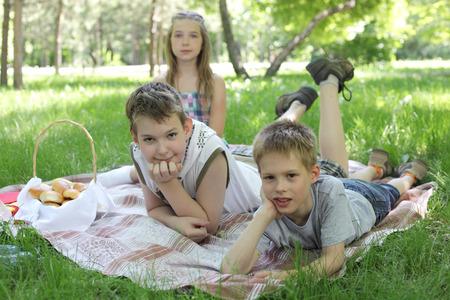 children summer picnic on the grass Stock Photo