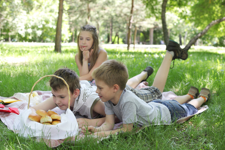 children summer picnic on the grass Stock Photo