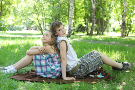 little kids relaxing in the park