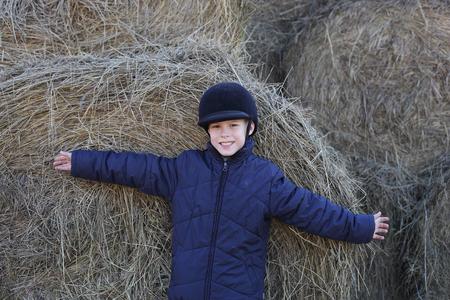 happy little boy on the horse farm