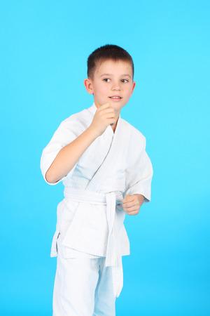 little boy demonstrating karate holds