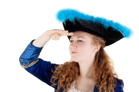 young pretty woman dressed as a pirate looking far away through the imaginary spyglass