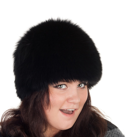 closeup image of the young serious girl in the fur cap