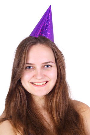closeup image of the pretty young girl in the birthday cap isolated on white
