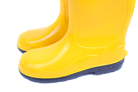 pair of the bright yellow rubber shoes Stock Photo