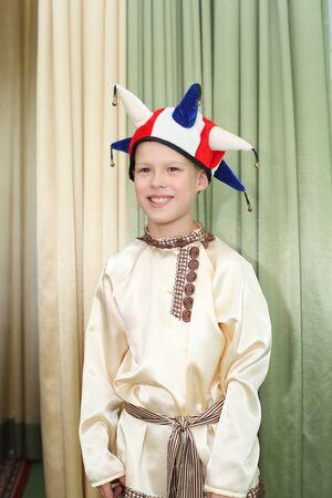 cute little boy playing a role of skomorokh