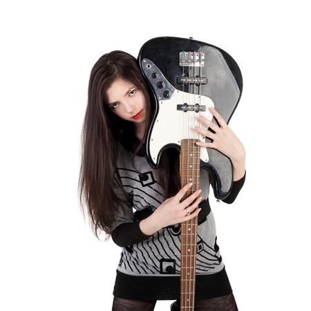 beautiful young brunette girl holding the electric guitar Foto de archivo