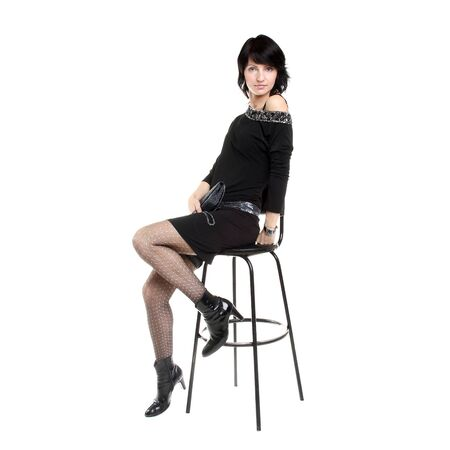pretty young woman posing in dress in studio Stock Photo