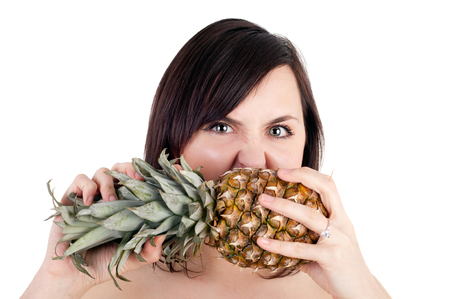 closeup image of the pretty young girl biting the pineapple