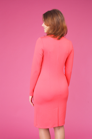 pretty young girl demonstrating a dress, back view